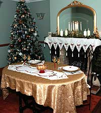 Dining scene with table linen and glassware in Celtic Christmas design