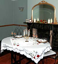 Table setting with Double Love Knot glassware and Ruby Rose table linen